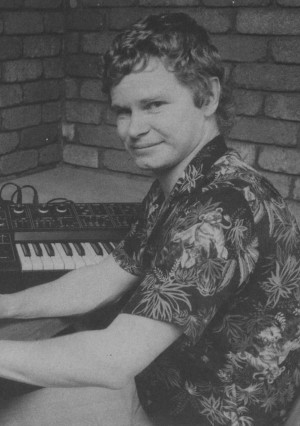 Photo of Greg Barnett at his computer